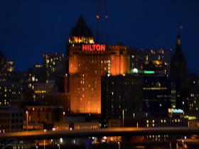 The Hilton shines in the distance.