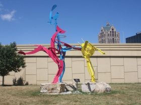 Three dancers in the new green space at N. 2nd St. and W.