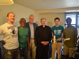 Jake Murray, Cornelius Jynes, Ald. Bob Bauman, Fr. Warren Sazama, S.J., Jonathan Medina, and Nana Yorke