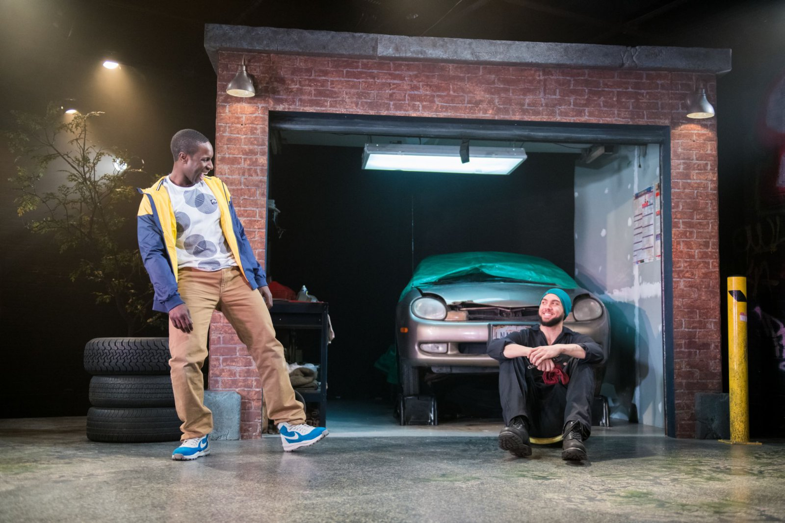L-R: Andrew Muwonge as Oshoosi Size, Travis A. Knight as Ogun Size