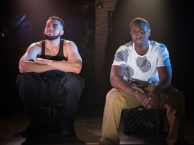 L-R: Travis A. Knight as Ogun Size, Andrew Muwonge as Oshoosi Size