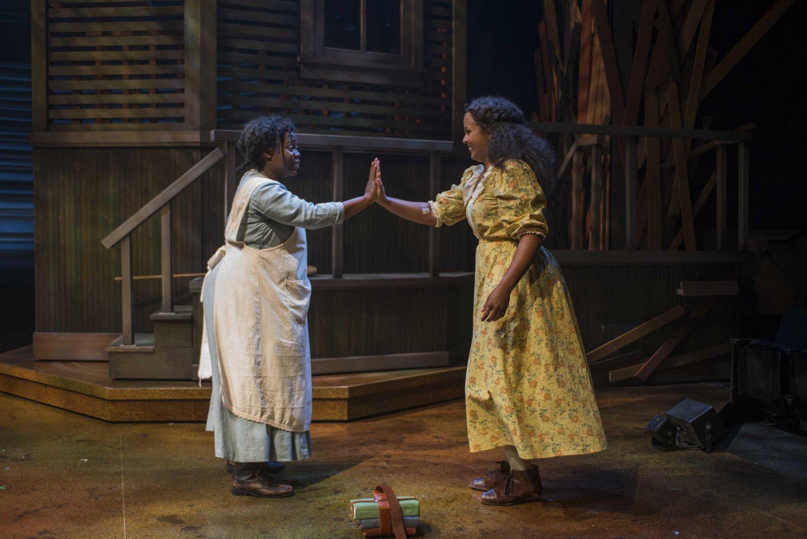 Zonya Love (Celie) and Stephanie Umoh (Nettie) in Milwaukee Repertory Theater's 2014/15 Quadracci Powerhouse production of The Color Purple.
