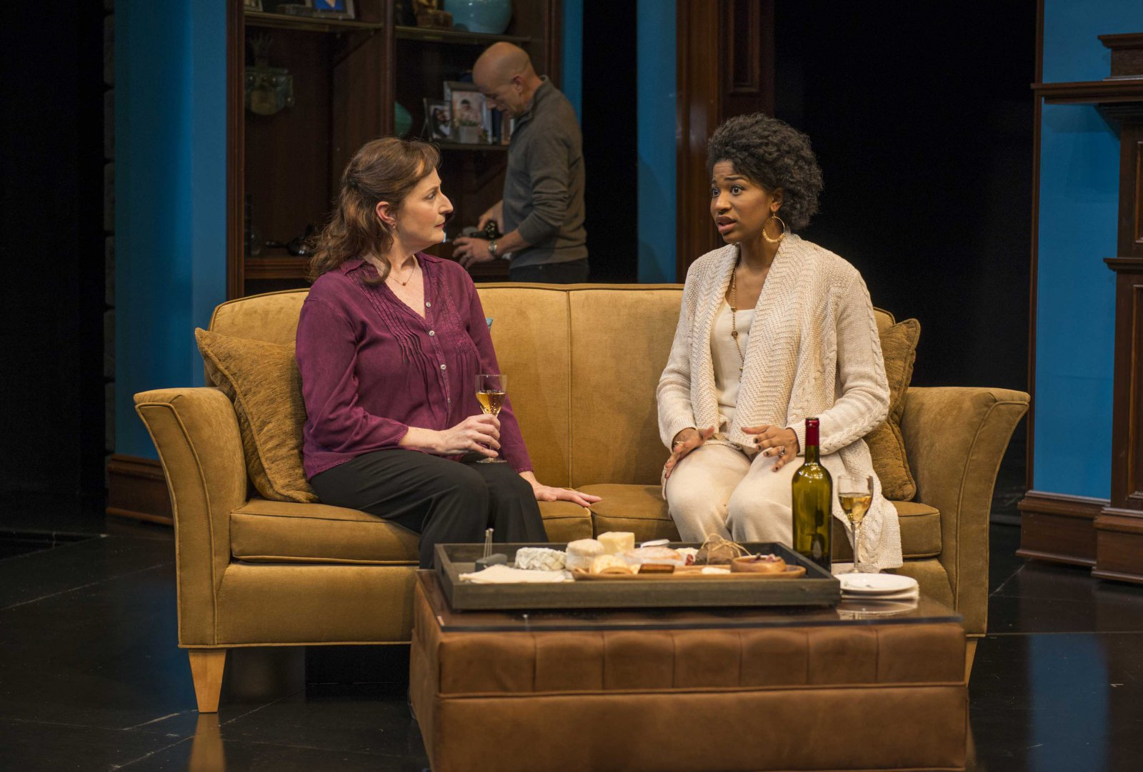 Laura Gordon and Jennifer Latimore (foreground), and Michael Elich (background) in Milwaukee Repertory Theater's 2014/15 Quadracci Powerhouse production of Good People.