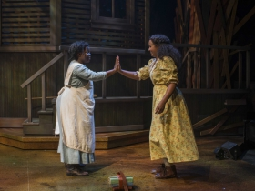 Zonya Love (Celie) and Stephanie Umoh (Nettie) in Milwaukee Repertory Theater's 2014/15 Quadracci Powerhouse production of The Color Purple.