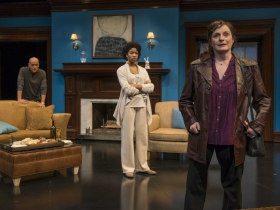 (L – R) Michael Elich (background), Jennifer Latimore, and Laura Gordon in Milwaukee Repertory Theater's 2014/15 Quadracci Powerhouse production of Good People.