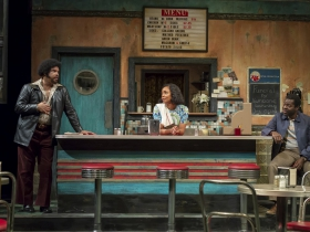 Wolf (Jefferson A. Russell), Risa (Malkia Stampley) and Sterling (Chiké Johnson) in Milwaukee Repertory Theater's production of August Wilson's Two Trains Running April 16 – May 12, 2019