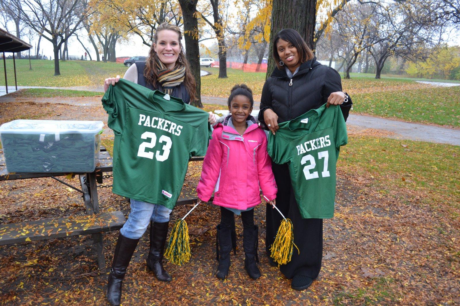 Future cheerleader Ahje Bethley, stands between Journey House volunteer parents Serena Rehka and Amorie Bethley