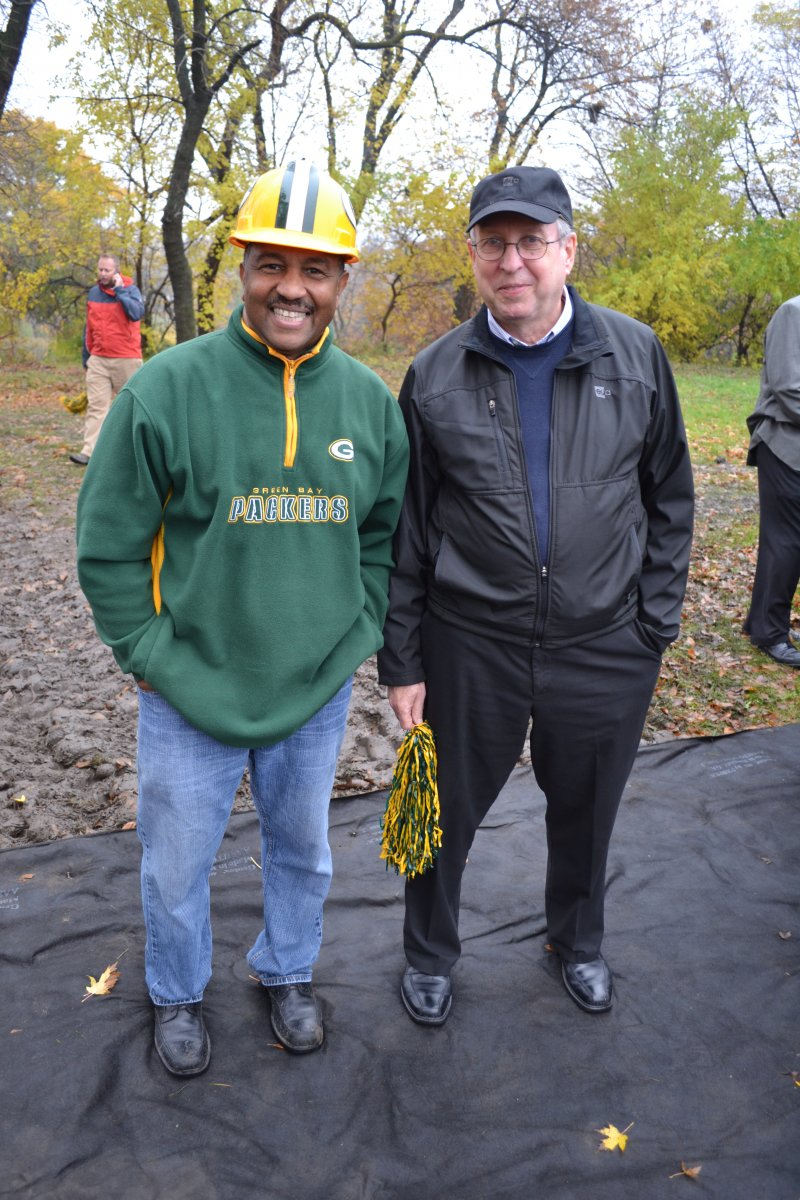Director of Youth Programs and football field sprearheader, Charles Brown,  awaits the ground breaking with principal Eppstein Uhen architect, Bob Cooper