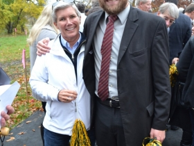 Former Milwaukee County Parks Director, Sue Black, celebrates her efforts to make the football field a reality in the company of 3rd District Alderman, Nik Kovac