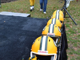 Packer helmets dramatically framed the scene