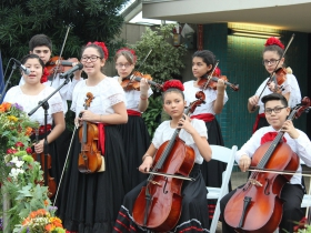 The Latino Arts Strings Program performing at the Domes Grand Reopening, December 1, 2016