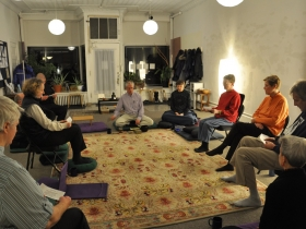 Paul Brodwin concludes a Wednesday night sangha at the Milwaukee Mindfulness Practice Center. Photo by Christine Pedretti.