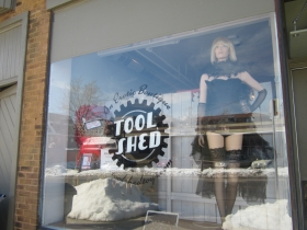 """The Tool Shed's window mannequin, """"Gracie,"""" sported wigs and cycling gear across the street at Cory the Bike Fixer before it was passed on, Laura Stuart said. Photo by Clair Sprenger."""