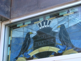 Stained glass sign above door.