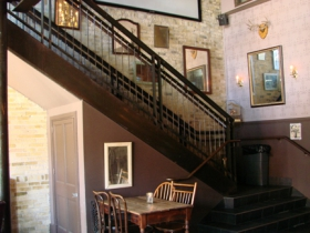 Stairway leading to the second level of Hotel Foster.