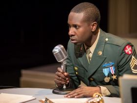 Andrew Muwonge in Next Act Theatre's unSilent Night.