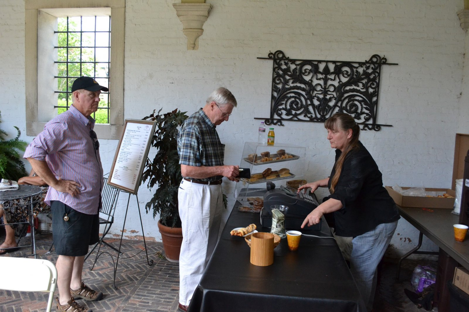 Guests buy coffee and baked goods from the Courtyard vendor
