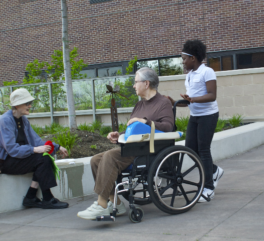 Girl from Our Next Generation with residents