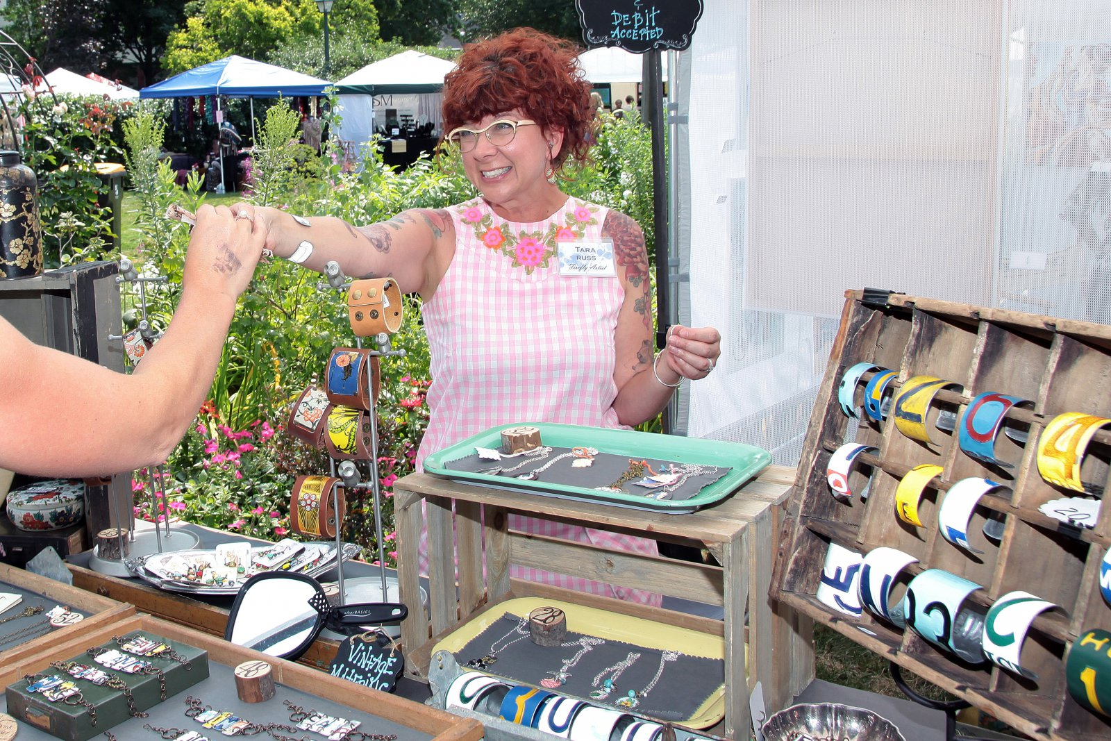 Artist Tara Russ designer of vintage tin, up cycled Frank and Bella\'s jewelry and boxes from Milwaukee