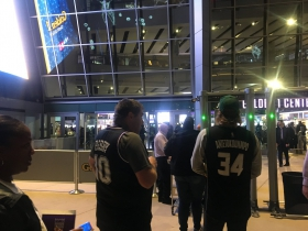 05-sac-kings-fan-in-a-bibby-jersey-bucks-fan-in-a-antetokounmpo-jersey-waiting-to-go-inside