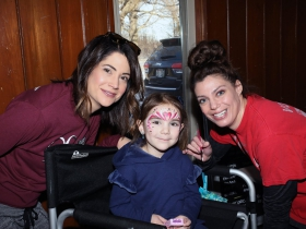 Erin Theriault, MCW Cardiovascular Center with daughter Nora and Katie Raebel from Katie Paints Faces