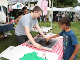 Ashia, from Wauwatosa, enjoyed the hands on print making demonstration by the UWM Print Narrative Forms Club at the Firefly Art Fair children's area