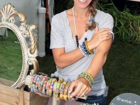 Leslie Winkelman, owner of Wear A Story, that features recycled glass bottles and brass bangels made into hand painted small jewelry designed from Ghana