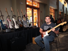 Playing a Fender guitar at the Cascio music booth, Yeril Lozano Torrez from Managua, Nicaragua, semi-finalists in the Rock/Blues competition
