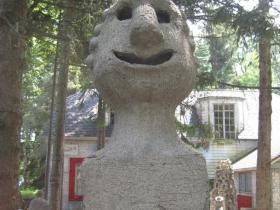 Sculpture guarding the property.
