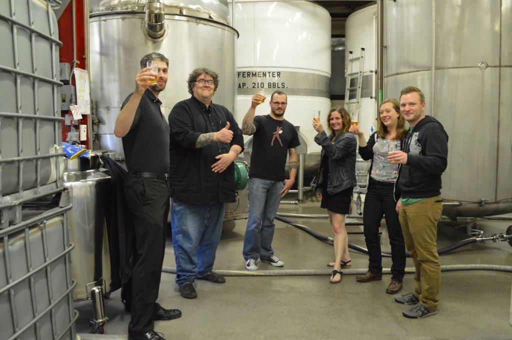 L – R:  Sprecher Sales Rep and WMSE DJ Ryan Aschebrook, Station GM Tom Crawford, Beer Creator and WMSE DJ Drew Walther, Promotions Director Sid McCain, Music Director Erin Wolf and Development Director Jay Burseth.