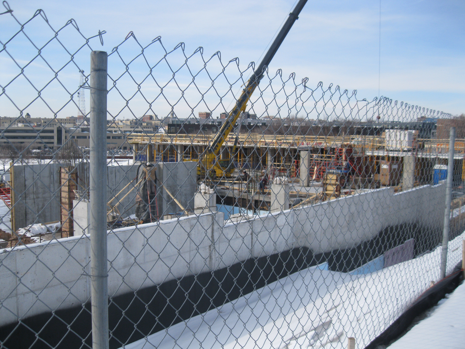 Looking through the construction fence.