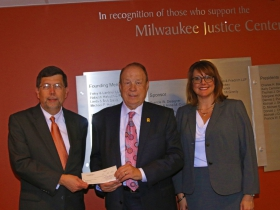 MBA Foundation President Francis W. Deisinger with Attorney Michael Hupy, and Mary Ferwerda, executive director of  the Milwaukee Justice Center.