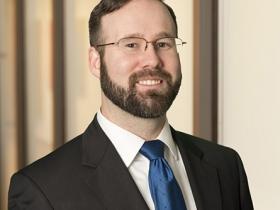 Aaron J. Foley