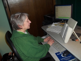 Cindy Kaczmarowski typing in braille. Photo courtesy of the Volunteer Center of Greater Milwaukee.