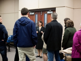 Janet Protasiewicz talking with a group.