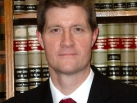 District Attorney John Chisholm