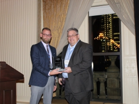 (l-r) Josh Brown, Milwaukee NARI President, presented the Building Milwaukee award to Andy Hepburn, Chief Innovation Officer, of GPS Education Partners.