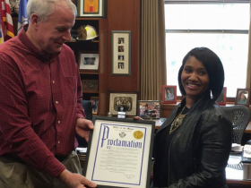Ms. Hall receives an official proclamation from Mayor Tom Barrett in Milwaukee's City Hall