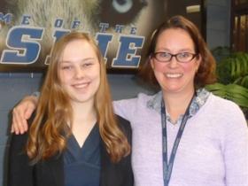 Reagan teacher Margaret Holtgreive with student Julia Brunson.