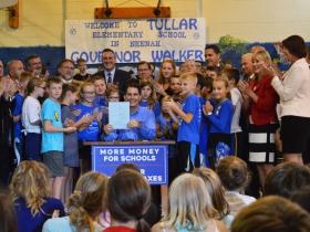Gov. Walker signs state budget.