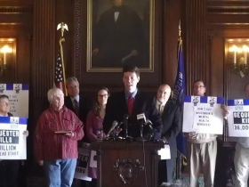 Robert Kraig speaking at a sequester press conference with congressman Pocan.