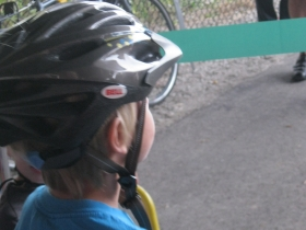 A young child waiting to ride the new trail.