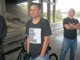 Bicyclists sporting a Milwaukee Home T-Shirt waits to ride the new trail.