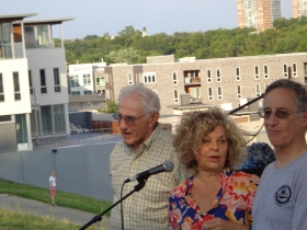 Leon Joseph listens while his wife Bonnie delivers some one-liners to the amusement of Tom Schneider.