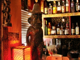 Front bar featuring tiki statue.