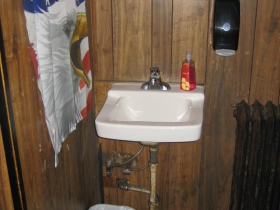 Old school -- hand washing station lets you keep up with doings at the bar while you scrub your mitts