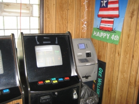 One of these machines dispenses cash.