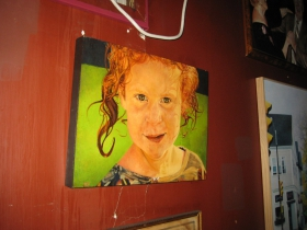 Not many taverns have childhood paintings of their bartenders hanging on the wall, but here is Mary by Mike Fredrickson.