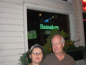 Husband and wife duo Shawnette Smart and Steve Johnson in front of their tavern.