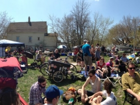 Panoramic view of bicyclists waiting to register for the Riverwest 24.